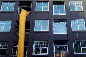 PROGRESS PHOTO OF MIX DEVELOPMENT IN DOWNTOWN ST. JOHN'S - URBAN APARTMENTS FOR LEASE